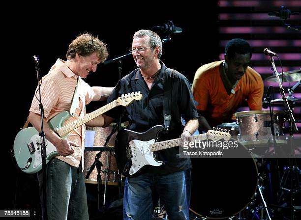 Musicians Steve Winwood Eric Clapton and drummer Steve Jordan perform during the Crossroads Guitar Festival 2007 held at Toyota Park on July 28 2007...