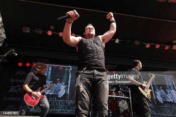 Musicians Steven Lee Dave Holowchak and Terry Freers of Ghosts of August perform during the 2012 Rock On The Range festival at Crew Stadium on May 20...