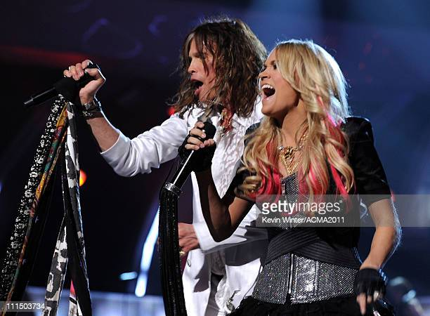 Musicians Steven Tyler and Carrie Underwood perform onstage during the 46th Annual Academy of Country Music Awards held at the MGM Grand Garden Arena...