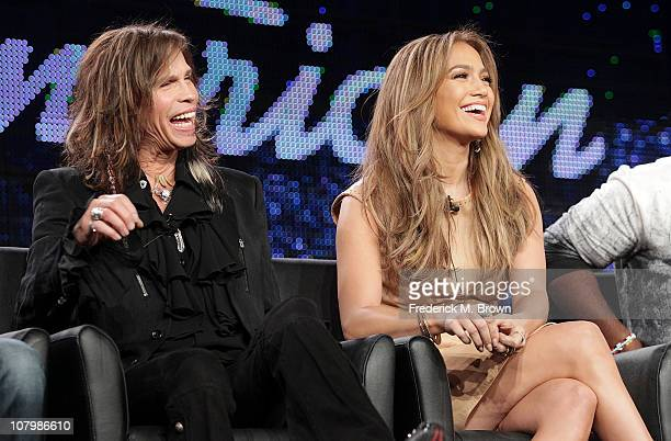 Musicians Steven Tyler and Jennifer Lopez speak onstage during the 'American Idol' panel at the FOX Broadcasting Company portion of the 2011 Winter...