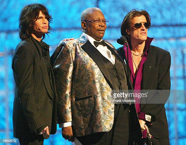 Musicians Steven Tyler and Joe Perry of Aerosmith and BB King present the Grammy for Best Rap Album at the 46th Annual Grammy Awards held at the...