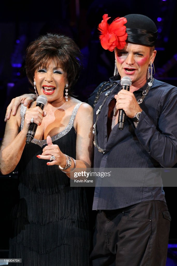 Musicians Sting and Dame Shirley Bassey perform on stage during the Almay concert to celebrate the Rainforest Fund's 21st birthday at Carnegie Hall on May 13, 2010 in New York City.