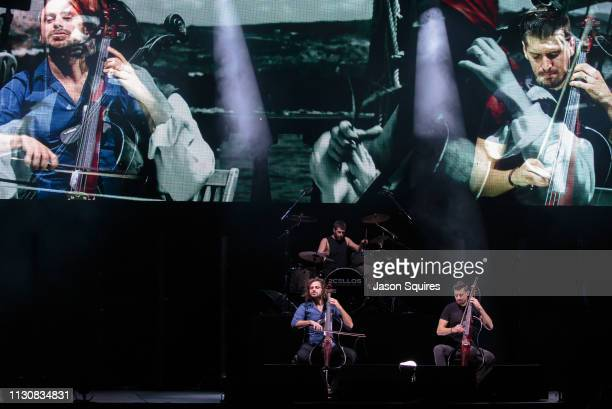 Musicians Stjepan Hauser and Luka Šulić of 2CELLOS and touring musician Dušan Kranjc perform at Sprint Center on February 19 2019 in Kansas City...