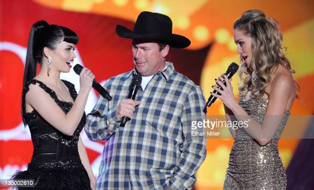 Musicians Susie Brown and Danelle Leverett of the Jane Dear Girls and musician Rodney Carrington speak onstage at the American Country Awards 2011 at...