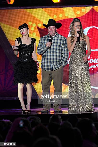 Musicians Susie Brown and Danelle Leverett of the Jane Dear Girls and musician Rodney Carrington speak onstage at the American Country Awards at the...
