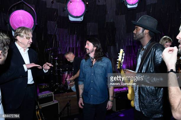 Musicians T Bone Burnett Dave Grohl of the Foo Fighters and Gary Clark Jr pose backstage for MusiCares Person of the Year honoring Tom Petty during...