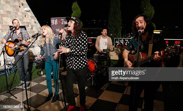 Musicians Tasso Smith Alice Katz Omar Ahmed Sam Martin Nik Hughes and Simon Katz of the band Youngblood Hawke perform onstage at the 987FM Penthouse...
