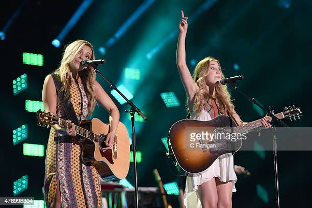 Musicians Taylor Elizabeth 'Tae' Dye and Madison Kay Marlow of Maddie and Tae perform at LP Field during the 2015 CMA Festival on June 12, 2015 in...