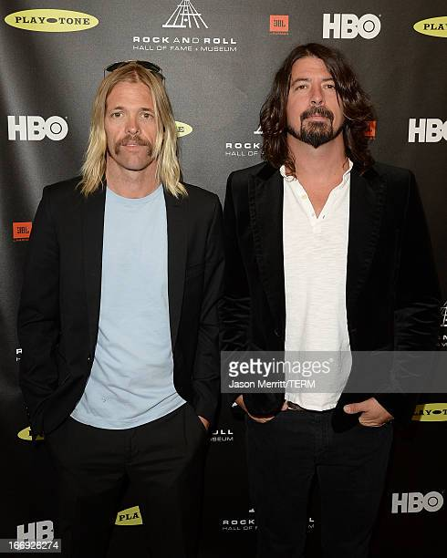 Musicians Taylor Hawkins and Dave Grohl of Foo Fighters arrive at the 28th Annual Rock and Roll Hall of Fame Induction Ceremony at Nokia Theatre LA...