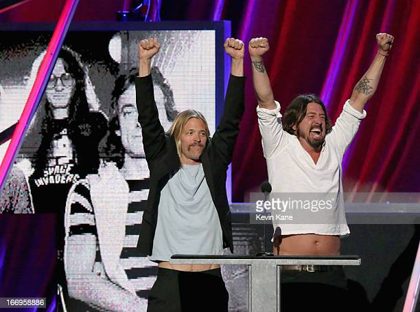 Musicians Taylor Hawkins and Dave Grohl speak onstage during the 28th Annual Rock and Roll Hall of Fame Induction Ceremony at Nokia Theatre LA Live...