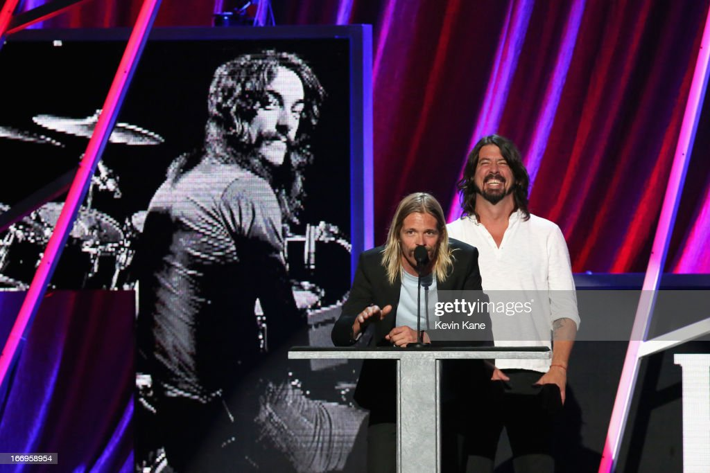 Musicians Taylor Hawkins (L) and Dave Grohl speak onstage during the 28th Annual Rock and Roll Hall of Fame Induction Ceremony at Nokia Theatre L.A. Live on April 18, 2013 in Los Angeles, California.