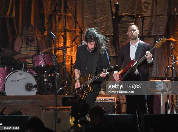 Musicians Taylor Hawkins Dave Grohl and Chris Shiftlett of the Foo Fighters perform onstage during MusiCares Person of the Year honoring Tom Petty at...