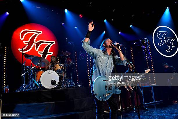 Musicians Taylor Hawkins Dave Grohl Chris Shiflett and Pat Smear perform onstage during the Foo Fighters SONIC HIGHWAYS album celebration hosted by...
