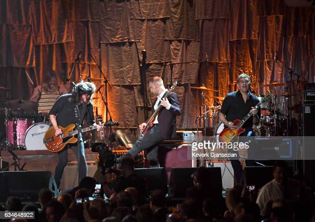 Musicians Taylor Hawkins Dave Grohl Nate Mendel and Pat Smear of Foo Fighters perform onstage during MusiCares Person of the Year honoring Tom Petty...
