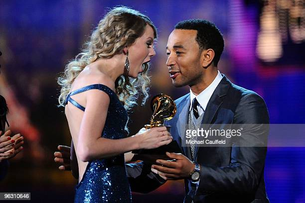 Musicians Taylor Swift and John Legend onstage at the 52nd Annual GRAMMY Awards held at Staples Center on January 31, 2010 in Los Angeles, California.
