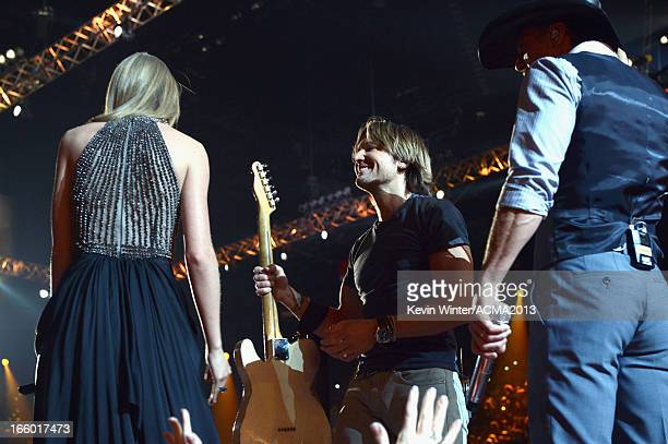 Musicians Taylor Swift Keith Urban and Tim McGraw perform onstage during the 48th Annual Academy of Country Music Awards at the MGM Grand Garden...