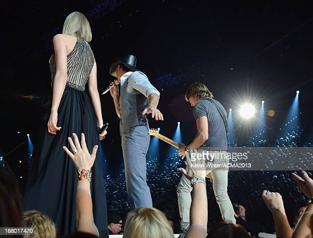 Musicians Taylor Swift Tim McGraw and Keith Urban perform onstage during the 48th Annual Academy of Country Music Awards at the MGM Grand Garden...