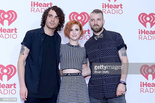 Musicians Taylor York, Hayley Williams and Jeremy Davis of Paramore pose in the press room during the 2014 iHeartRadio Music Festival at MGM Grand...