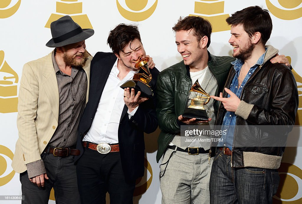 Musicians Ted Dwane, Marcus Mumford, Ben Lovett and Country Winston-Marshall of Mumford & Sons, winners of Best Long Form Music Video and Album of the Year, pose in the press room at the 55th Annual GRAMMY Awards at Staples Center on February 10, 2013 in Los Angeles, California.