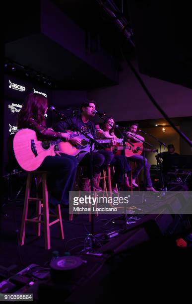 Musicians Tenille Townes Steven Lee Olsen Jillian Jacqueline and Jordan Davis perform for the CMA Songwriters Series while musicians look on during...