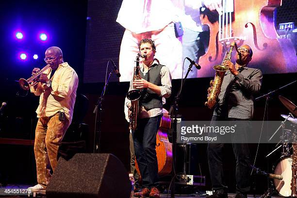 Musicians Terence Blanchard Brice Winston and Ravi Coltrane performs during the 36th Annual Chicago Jazz Festival at Millennium Park on August 29...