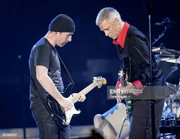 Musicians the Edge and Adam Clayton of U2 performs on stage on the first night of their Vertigo//2005 World Tour at the San Diego Sports Arena on...