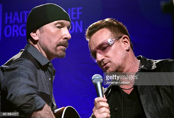 Musicians The Edge and Bono of U2 perform onstage during the 3rd annual Sean Penn Friends HELP HAITI HOME Gala benefiting J/P HRO presented by...