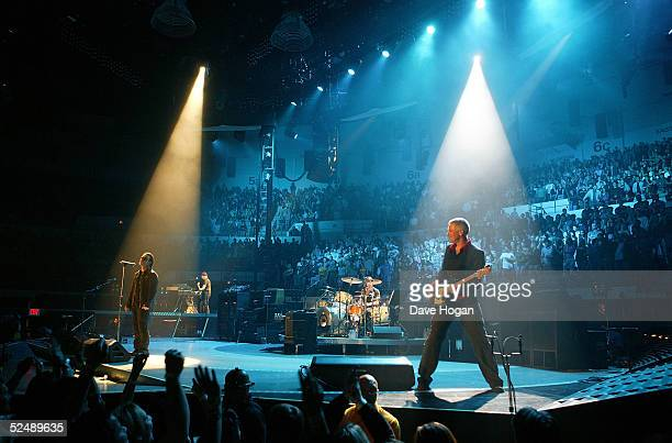Musicians The Edge Bono Adam Clayton and Larry Mullen Jr of U2 perform on stage on the first night of their Vertigo//2005 World Tour at the San Diego...