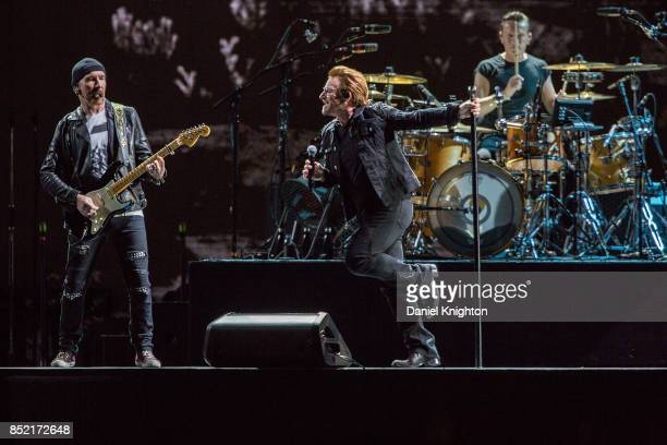 Musicians The Edge Bono and Larry Mullen Jr perform on stage on the final night of U2 The Joshua Tree Tour 2017 at SDCCU Stadium on September 22 2017...