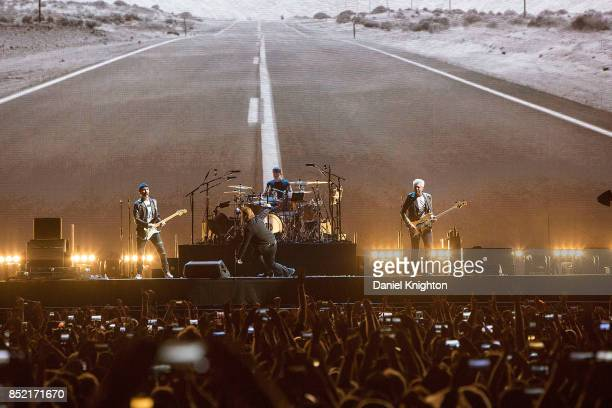 Musicians The Edge Bono Larry Mullen Jr and Adam Clayton of U2 perform on stage on the final night of U2 The Joshua Tree Tour 2017 at SDCCU Stadium...