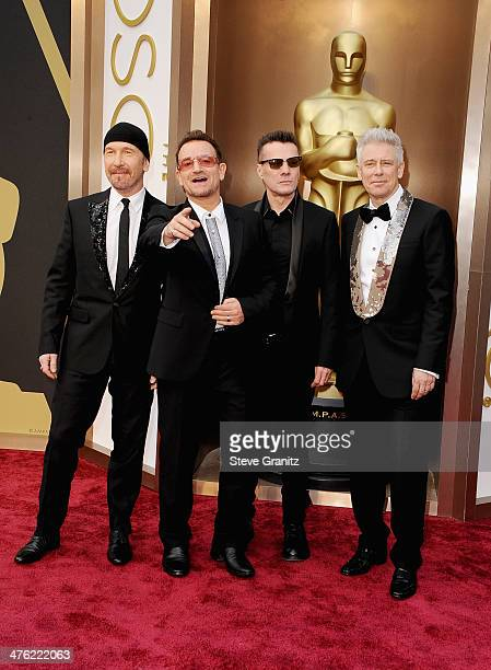 Musicians The Edge Bono Larry Mullen Jr and Adam Clayton of U2 attends the Oscars held at Hollywood Highland Center on March 2 2014 in Hollywood...