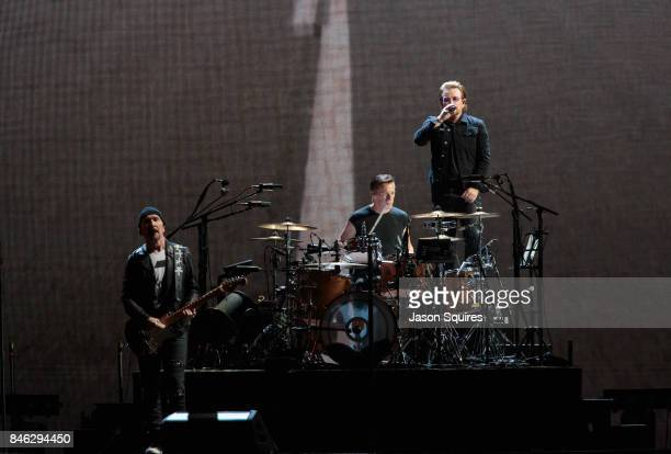 Musicians The Edge Larry Mullen Jr and Bono of U2 perform during The Joshua Tree Tour 2017 at Arrowhead Stadium on September 12 2017 in Kansas City...