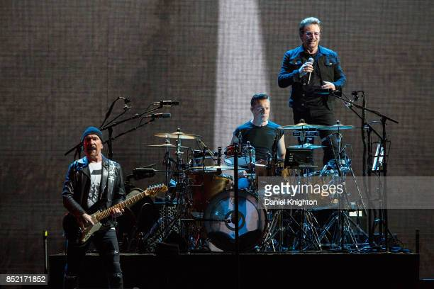 Musicians The Edge Larry Mullen Jr and Bono of U2 perform on stage on the final night of U2 The Joshua Tree Tour 2017 at SDCCU Stadium on September...