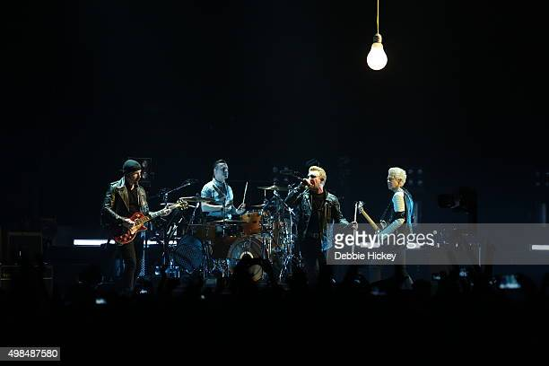 Musicians The Edge Larry Mullen Jr Bono and Adam Clayton of U2 perform onstage at 3 Arena on November 23 2015 in Dublin Ireland
