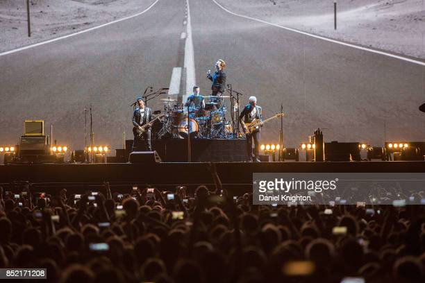 Musicians The Edge Larry Mullen Jr Bono and Adam Clayton of U2 perform on stage on the final night of U2 The Joshua Tree Tour 2017 at SDCCU Stadium...