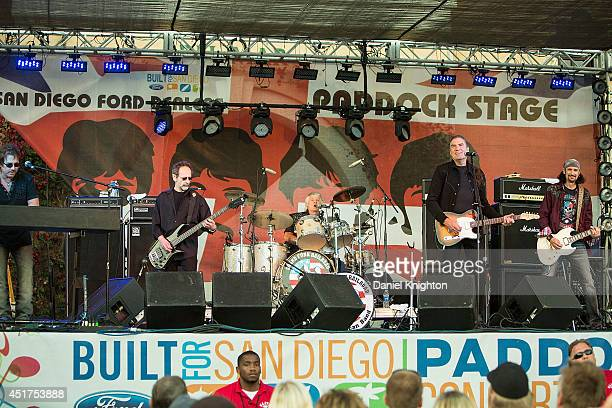 Musicians Tim Cashion Mel Schacher Don Brewer Max Carl and Bruce Kulick of Grand Funk Railroad perform on stage at the San Diego County Fair on July...