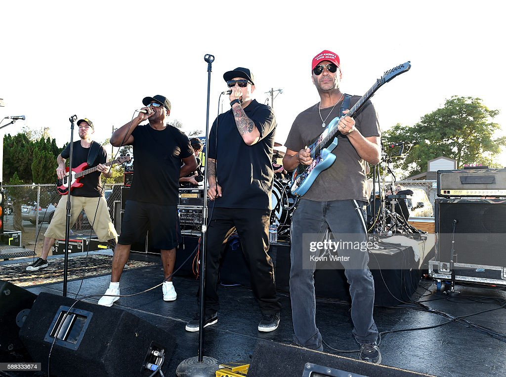 Musicians Tim Commerford, Chuck D, B-Real and Tom Morello of Prophets of Rage perform outside of the California Rehabilitation Center on August 10, 2016 in Norco, California.