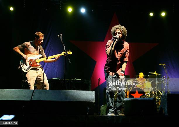 Musicians Tim Commerford Zack De La Rocha and Brad Wilk from the band Rage Against the Machine perform during day 3 of the Coachella Music Festival...
