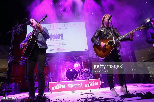 Musicians Tim Lopez and Tom Higgenson of Plain White T's perform onstage during the 'Live at the Atrium' Holiday Concert Series in Partnership with...