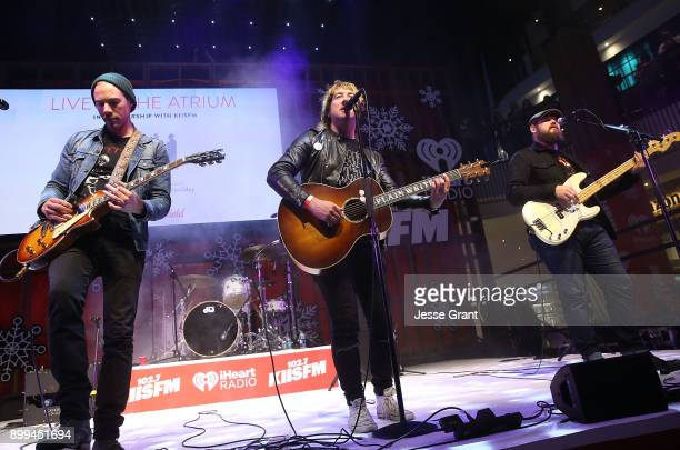 Musicians Tim Lopez Tom Higgenson and Mike Retondo of Plain White T's perform onstage during the 'Live at the Atrium' Holiday Concert Series in...