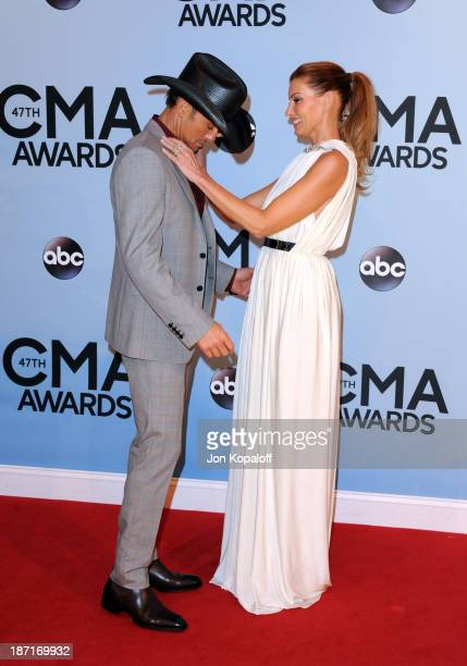 Musicians Tim McGraw and Faith Hill attend the 47th annual CMA Awards at the Bridgestone Arena on November 6 2013 in Nashville Tennessee