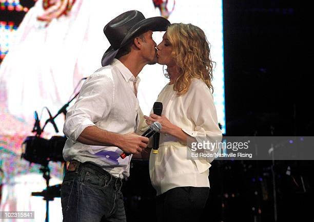 Musicians Tim McGraw and Faith Hill onstage at Nashville Rising a benefit concert for flood relief at Bridgestone Arena on June 22 2010 in Nashville...