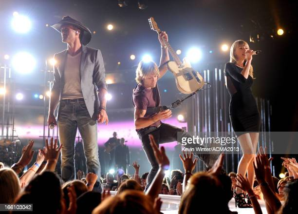 Musicians Tim McGraw Keith Urban and singer Taylor Swift perform onstage during Tim McGraw's Superstar Summer Night presented by the Academy of...