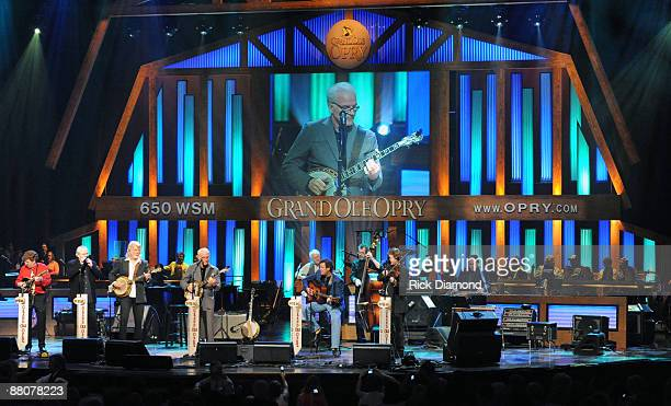 Musicians Tim O'Brien Gary Scruggs John McEuen Steve Martin Vince Gill and Stuart Duncan Join Steve Martin on stage at his debut concert at the Grand...