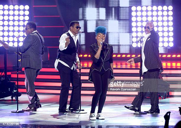 Musicians Tito Jackson Jackie Jackson and Marlon Jackson of The Jackson Five perform onstage with American Idol finalist Tyanna Jones during...