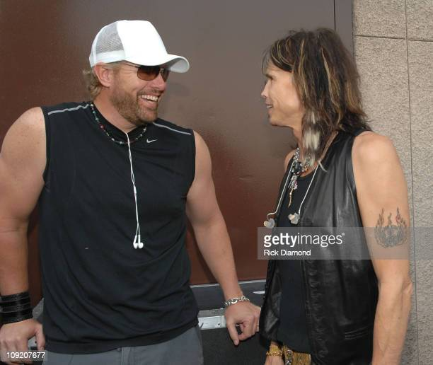 Musicians Toby Keith and Steven Tyler backstage during CMT Giants honoring Hank Williams Jr at the Gibson Amphitheatre on October 25 2007 in Los...