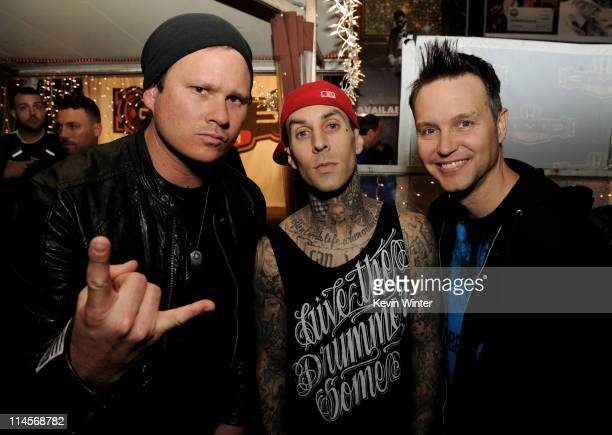 Musicians Tom DeLonge, Travis Barker and Mark Hoppus of blink-182 pose at a press party of announce the 2011 Honda Civic Tour featuring blink-182 and...