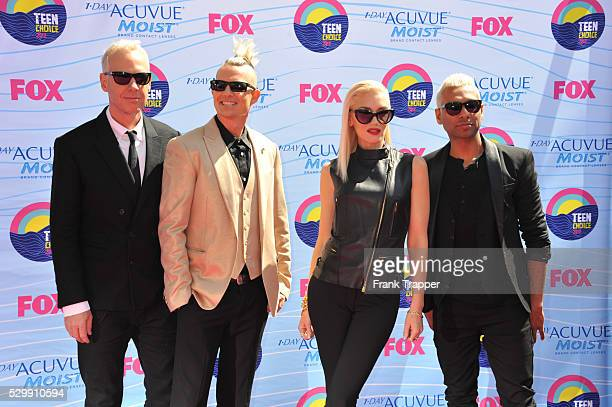 Musicians Tom Dumont Adrian Young Singer Gwen Stefani and musician Tony Ashwin Kanal of No Doubt arrive at the 2012 Teen Choice Awards held at the...