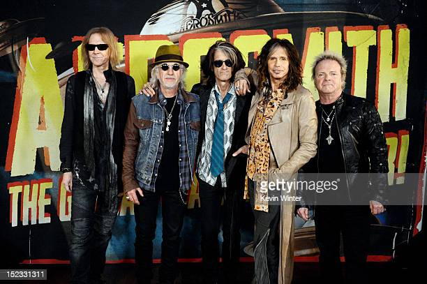Musicians Tom Hamilton Brad Whitford Joe Perry Steven Tyler and Joey Kramer of Aerosmith pose at the press junket to announce their new album Music...