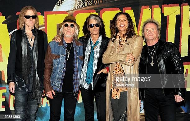 Musicians Tom Hamilton, Brad Whitford, Joe Perry, Steven Tyler and Joey Kramer of Aerosmith pose at the press junket to announce their new album...